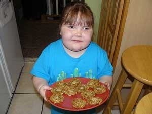 obese girl with cookies